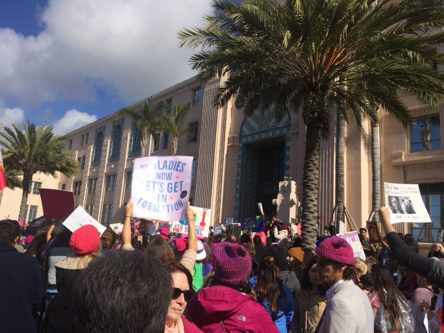 The+crowd+stands+in+front+of+the+County+Administration+Center+during+the+San+Diego+Women%27s+March+on+Jan.+21.