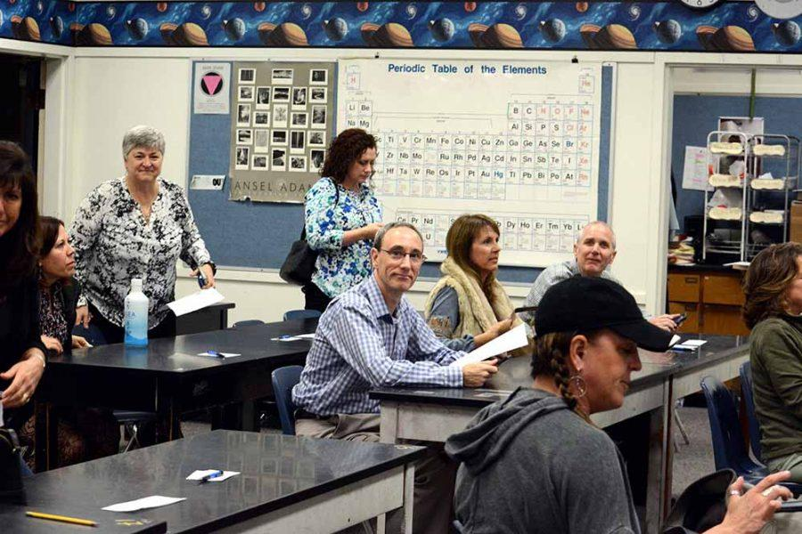 Parents arrive in chemistry teacher Russ Davidsons classroom to learn about the class.
