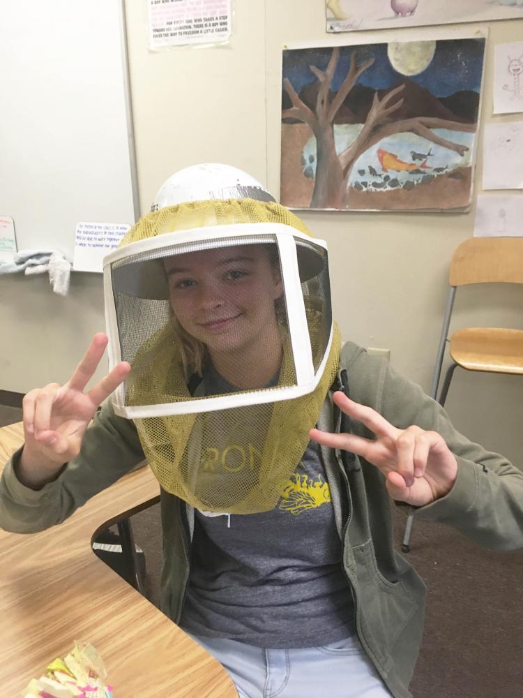 Madeline Larosche in her beekeeping gear.