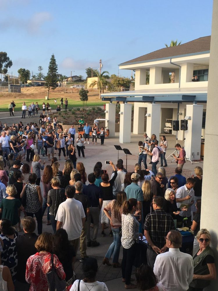 Parents gather in the new building courtyard during Back to School Night.