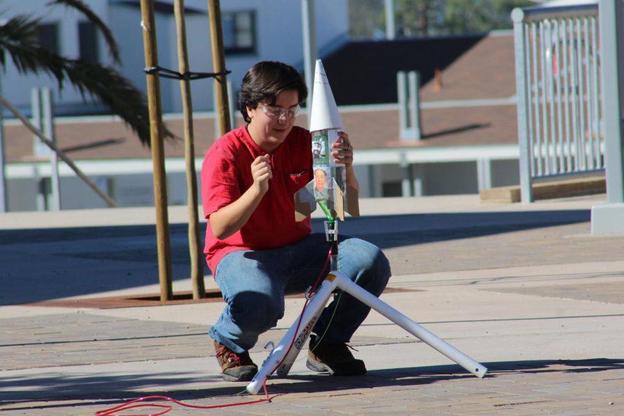 Junior+David+Detweiler+prepares+his+rocket+for+launch.