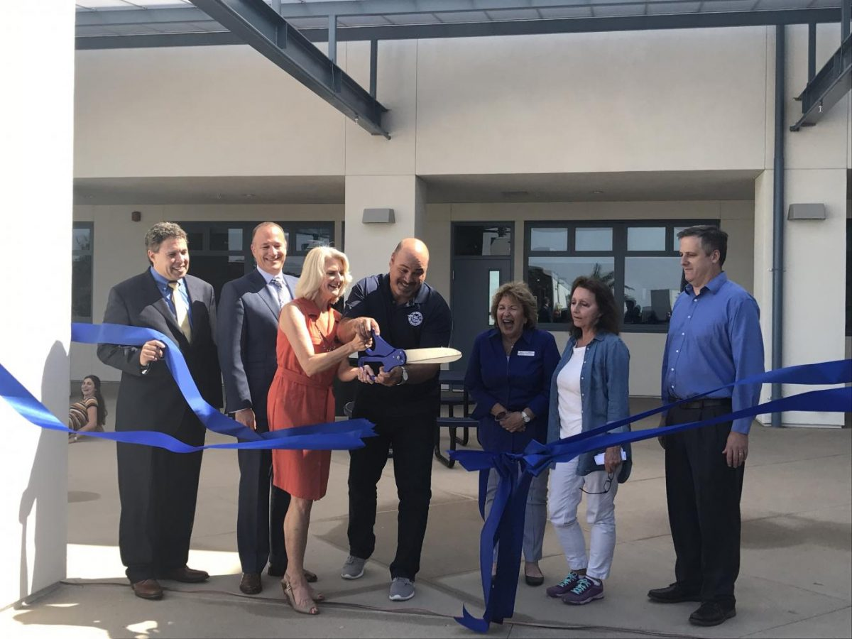 Staff and administration members, including chemistry teacher Russ Davidson, Principal Adam Camacho and math teacher Gail Lee, participated in the ribbon cutting ceremony last Friday.