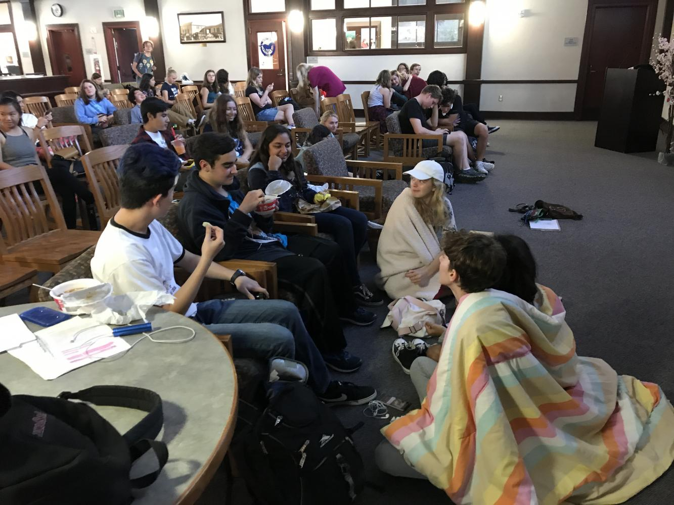 Students watched the film intently while enjoying their boba, lo mein, rice cakes, and ramune.
