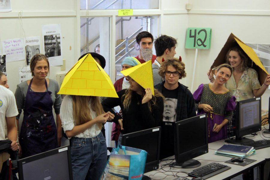 Students wear some sharp pyramid hats.
