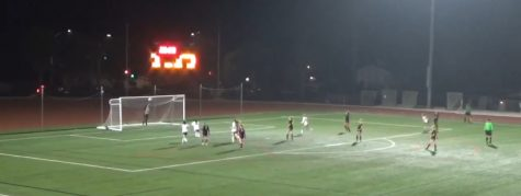 Senior Brittany Reppenhagen scores first goal of match off of a free kick.