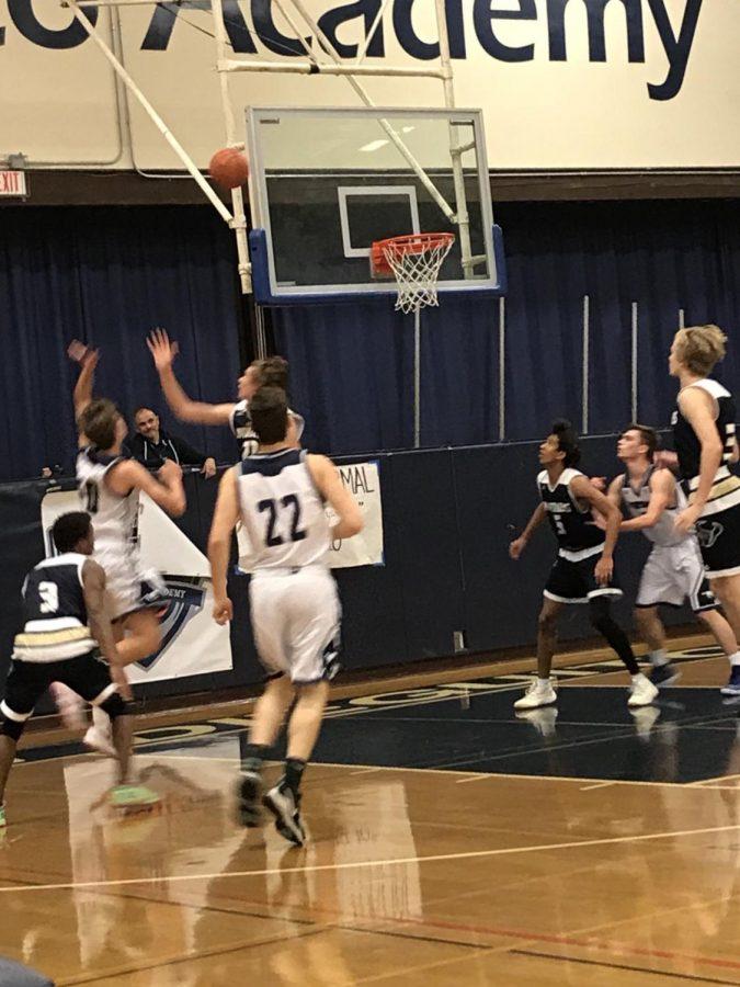 SDA boys basketball plays hard against LCC.