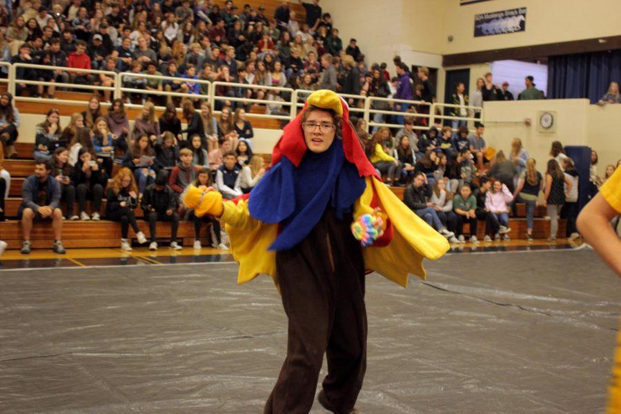 Sophomore David Salzmann hypes up the crowd as the Team Paradox mascot.