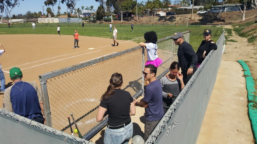 Some teachers waiting in the dugout for their chance at victory.