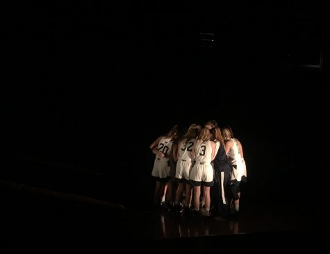 The San Dieguito team huddles together before the start of the big game.