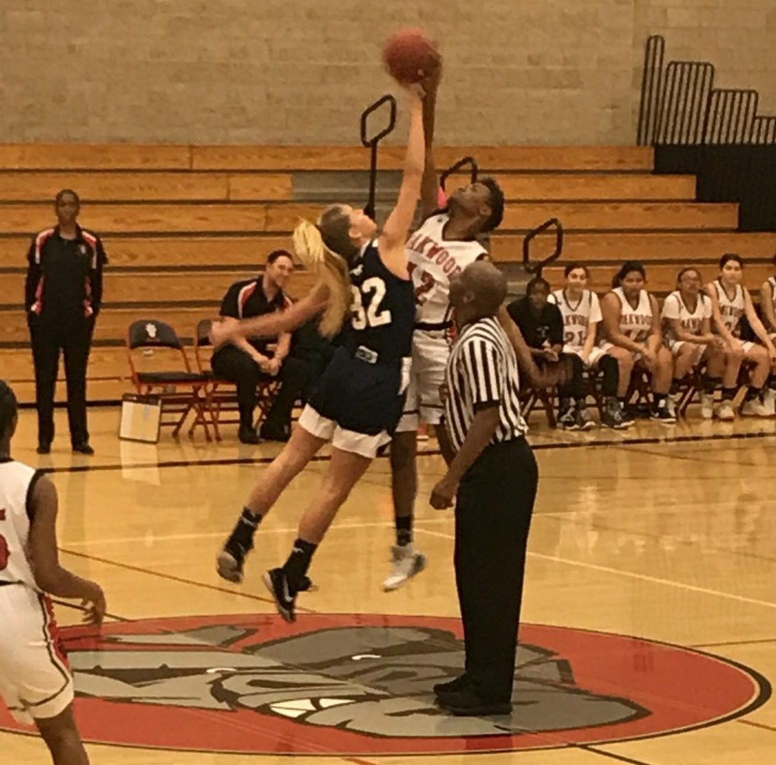 The SDA girls basketball team competes with Oakland to get the jump ball.