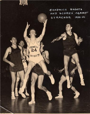 Old photo of Roger Chadwick making one of many college basketball shots.