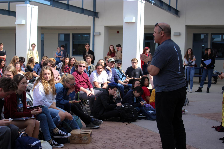 Principal Adam Camacho addresses students at this month's forum.