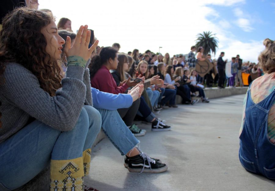 Students applaud after a speech.