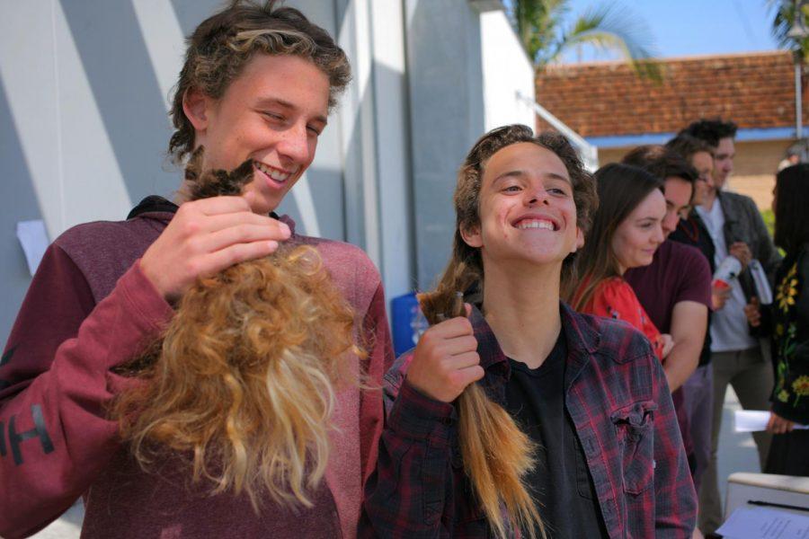Freshman Walker Mayer and sophomore Shawlin Tucker show off their new hair.