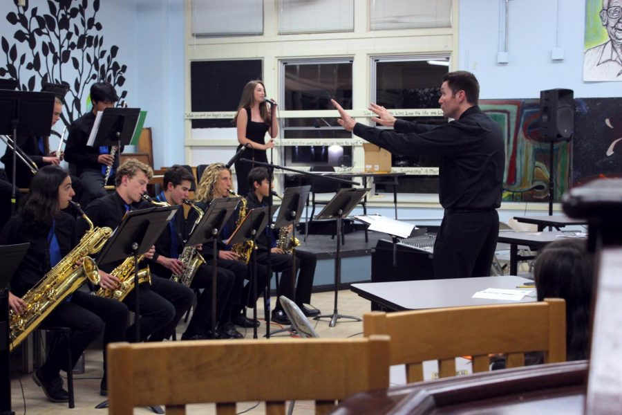 Music+teacher+Jeremy+Wuertz+conducts+the+SDA+Jazz+Band%2C+accompanied+by+senior+Jenna+Steinberg.