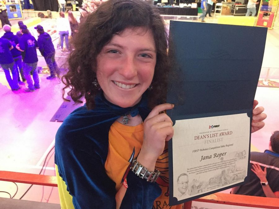 Jana+holding+up+her+certificate%21