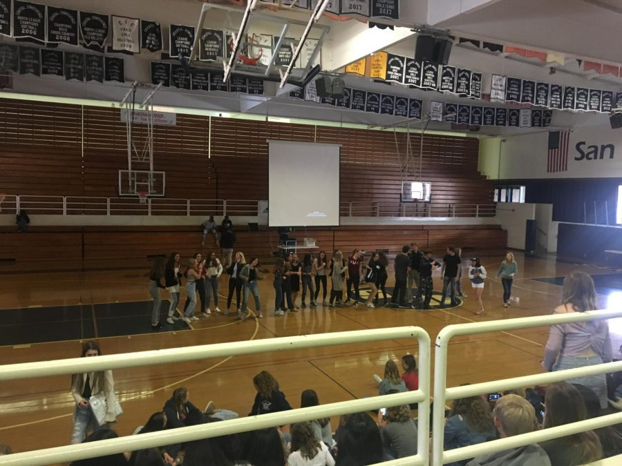 Freshmen dance to the song YMCA in the gym