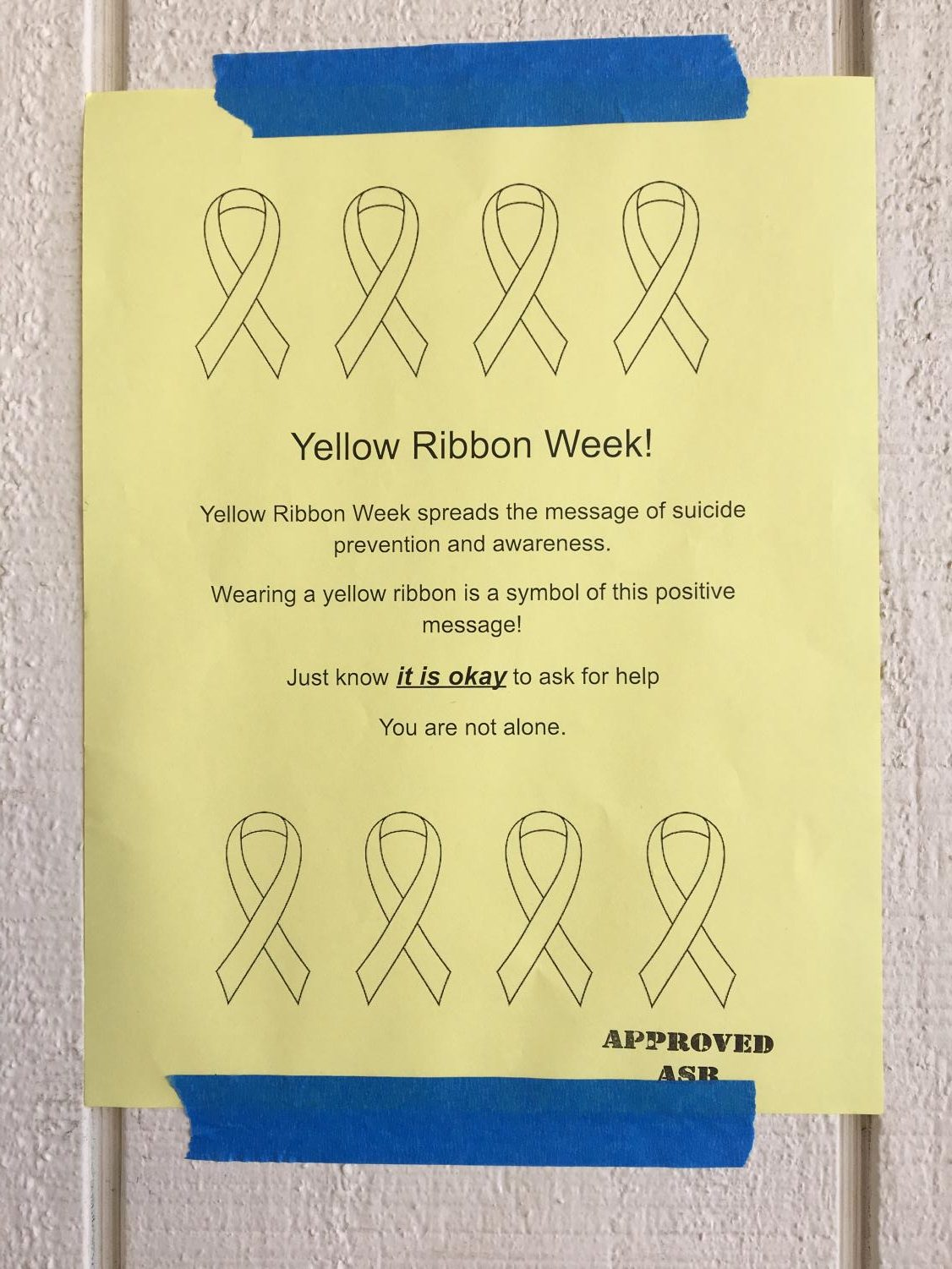 Posters are up around campus reminding students to wear yellow on Friday.
