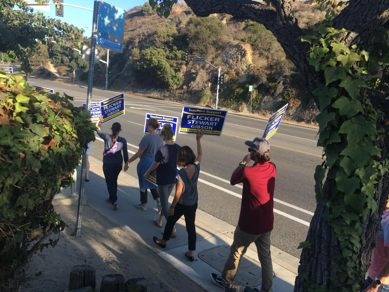 SDFA members carried signs promoting their three endorsed candidates during a demonstration last Thursday.
