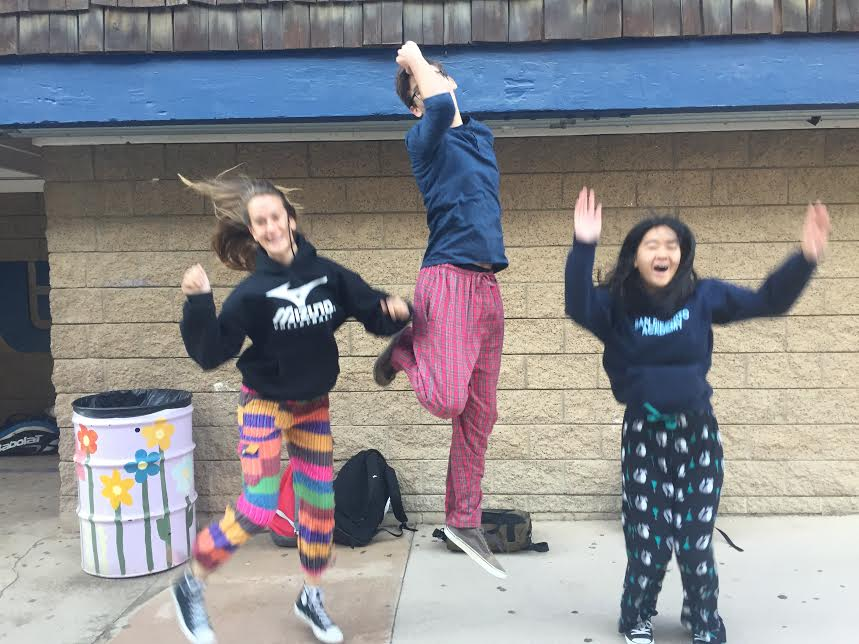 Students+jump+for+joy+in+their+sleepwear.