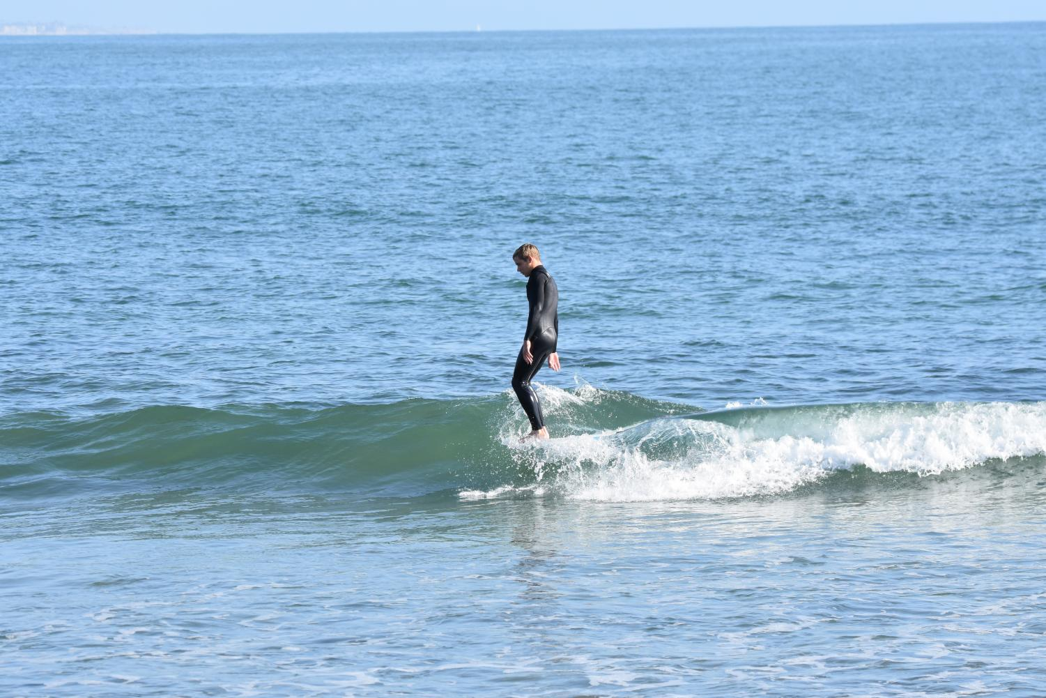 Senior Jack Butler competes in Sunday's surf contest.