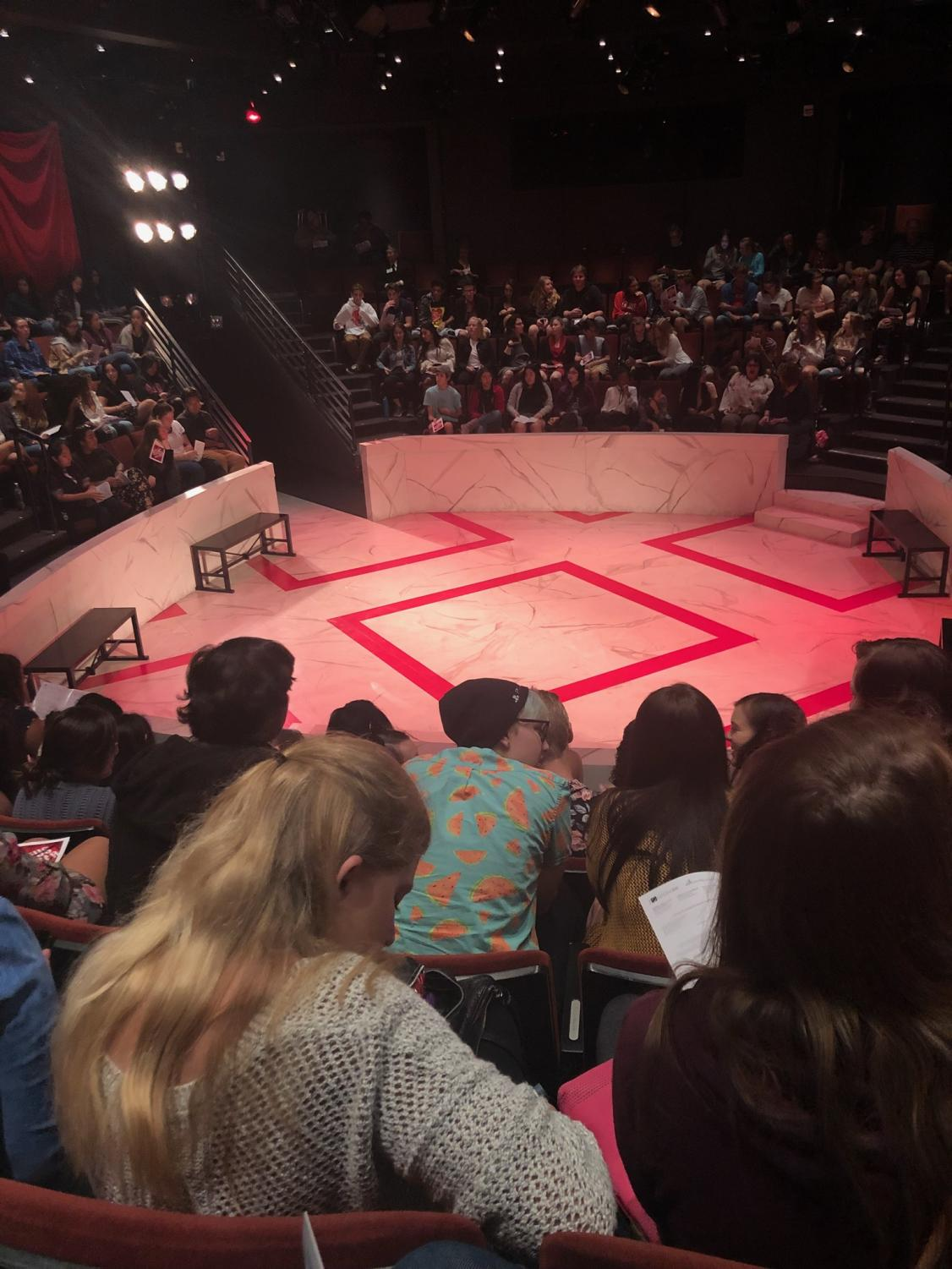 The round at the Old Globe where the show was performed. Note the marble painted floor and red design.