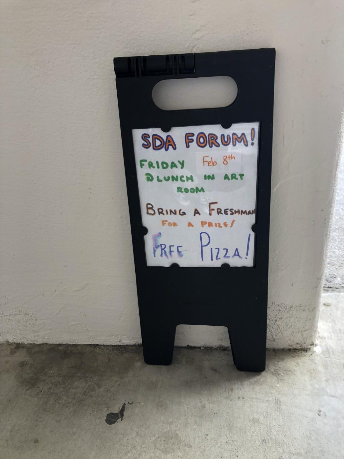 One of many signs posted around campus advertising the forum.
