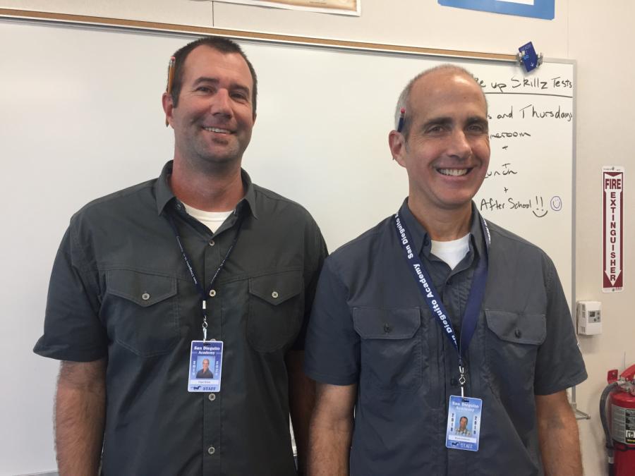 Math teachers Bryan Anderson and Paul Brice matching.