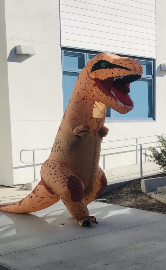 An+anonymous+student+wanders+the+halls+dressed+as+a+dinosaur.