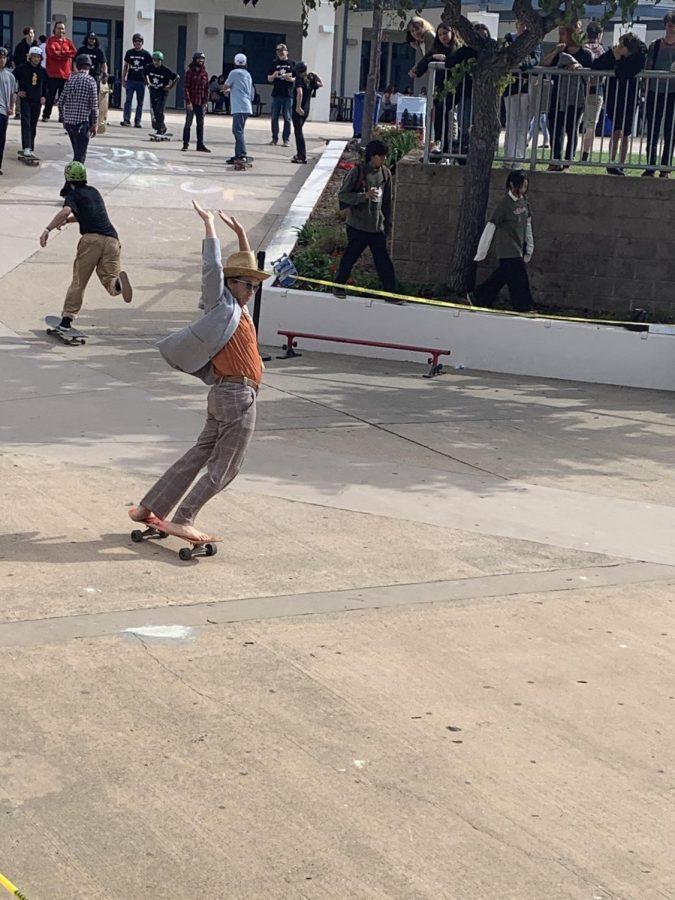 Art teacher Jeremy Wright participates in the Skate Demo.