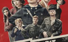 Jojo Betzler (Roman Griffin Davis) and his imaginary friend Adolf Hitler (Taika Waititi) run through a forest.