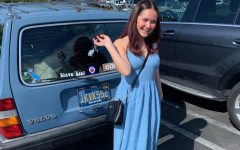 Junior Amelia Armstrong matches her car in a baby blue dress.