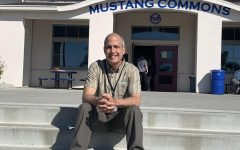 Math teacher Paul Brice sits in front of the Mustang Commons.