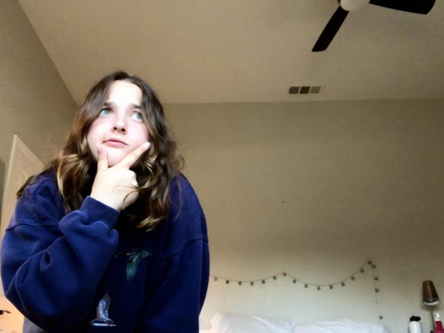 Kate pondering life in her room.