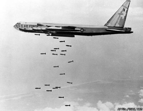 A US Air Force plane dropping bombs over Cambodia.