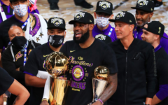 LeBron James celebrates after winning his first championship with the Los Angeles Lakers and fourth NBA Finals total