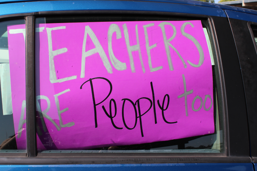 "A teacher attached ""Teachers are people too"" poster on their car window"