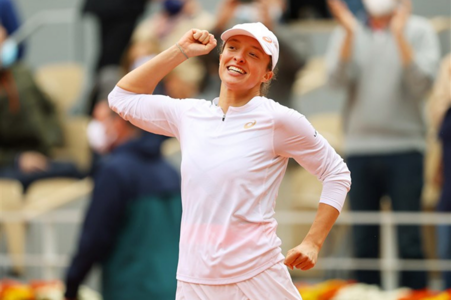 Iga Swiatek of Poland celebrates after winning the championship point at the French Open on Oct. 10, 2020