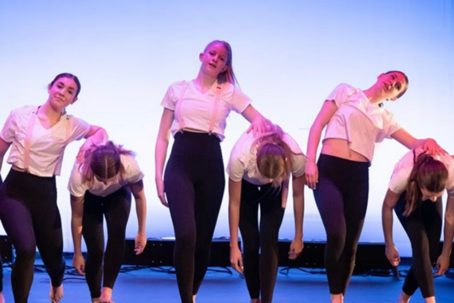 From left to right: Junior Serena Herold, College freshman Lily Teisher and Sophomore Layla Curley perform Anthony Rodriguez's piece at the SDA Dance Ensemble's showcase Feb.7, 2020