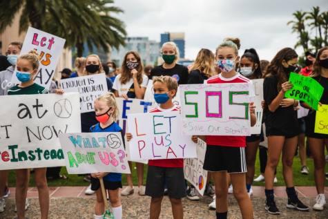 Youth soccer players rally in front of San Diego County Administration Center Oct.10, 2020