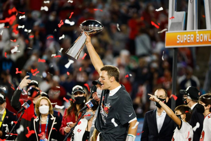 Tom Brady hoisting the Lombardi Trophy for the seventh time after defeating the Kansas City Chiefs
