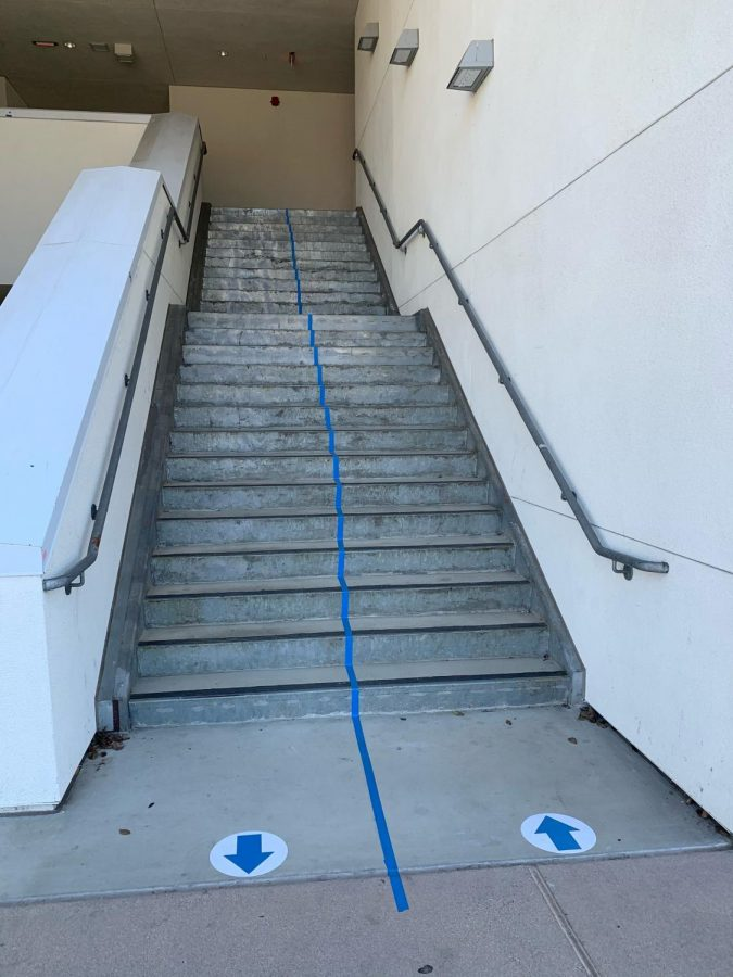 Stairways have direction marks to prevent students from running into one another