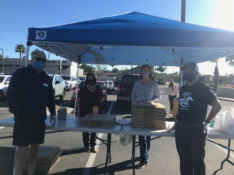 From left to right: Kevin Baum, Lisa Tucker, Stephanie Baum, and Kathy Urbanic volunteering at the booth in the front parking lot on Feb. 18, 2021