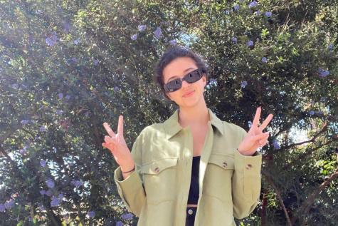 Senior Anna de la Fuente celebrates spirt day by sporting her green attire.