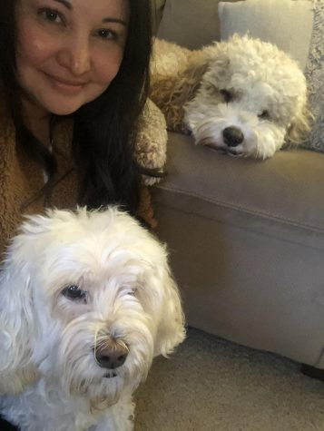 Spanish teacher Ivonn Barriga with her dogs Wrigley and Kona