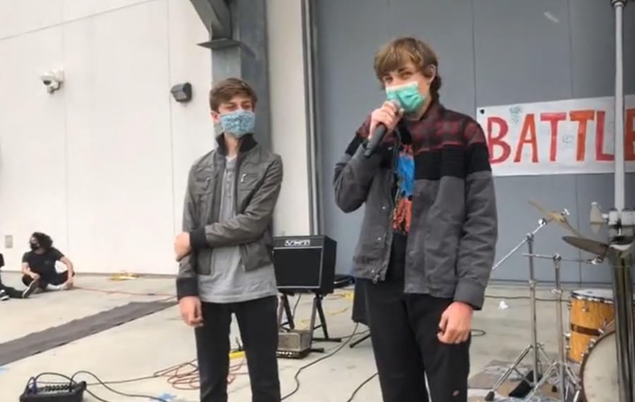 two boys giving a speech