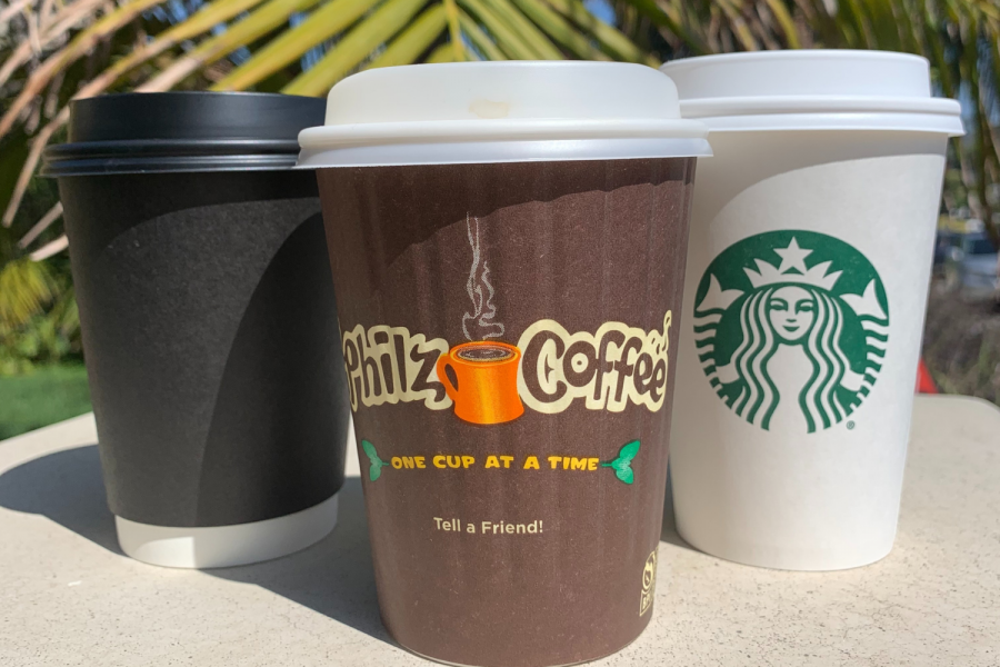 Black cup, brown cup, and white cup lined in a row