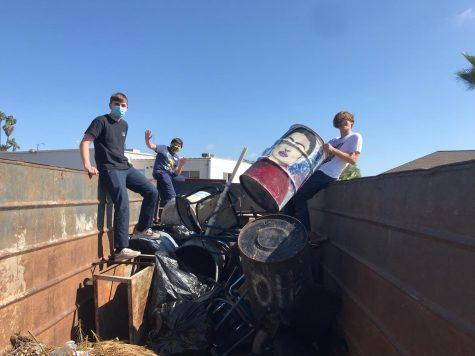 Three SDA students help Max Vennemeyer  rescue the Frida Kahlo trash can.