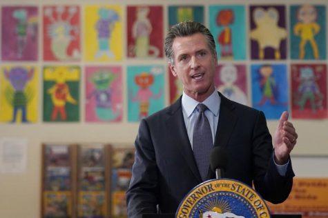 Governor Gavin Newsom announces his mandate at James Denman Middle School in San Francisco. Courtesy of AP Photo/Jeff Chiu