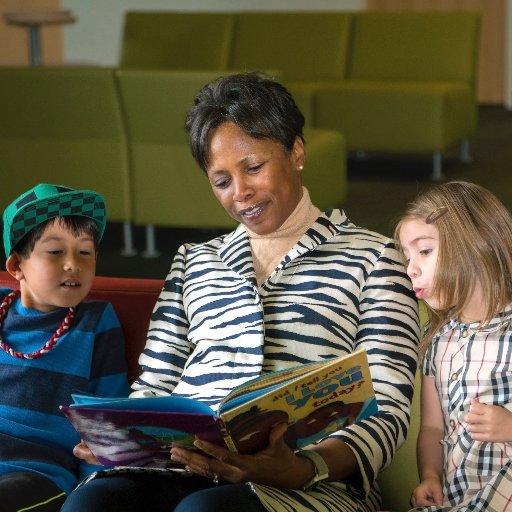 Cheryl James-Ward reading to children. Courtesy of @CJamesWard4Brd on Twitter.